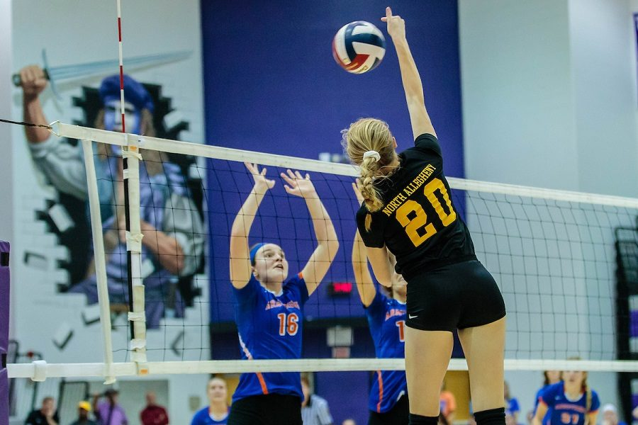 Junior Avery Tuman goes up for a kill during the WPIAL Championship game.