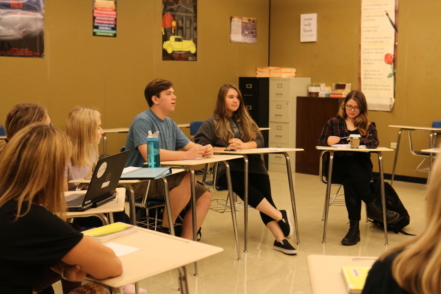 Students in Ms. Walters' 2nd period class discuss their latest read.