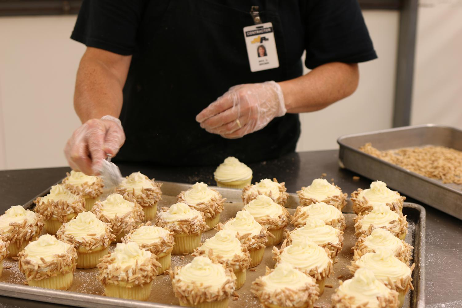 The NASH cafeteria puts the finishing touches on cupcakes for Cohen to be sold at Homecoming.