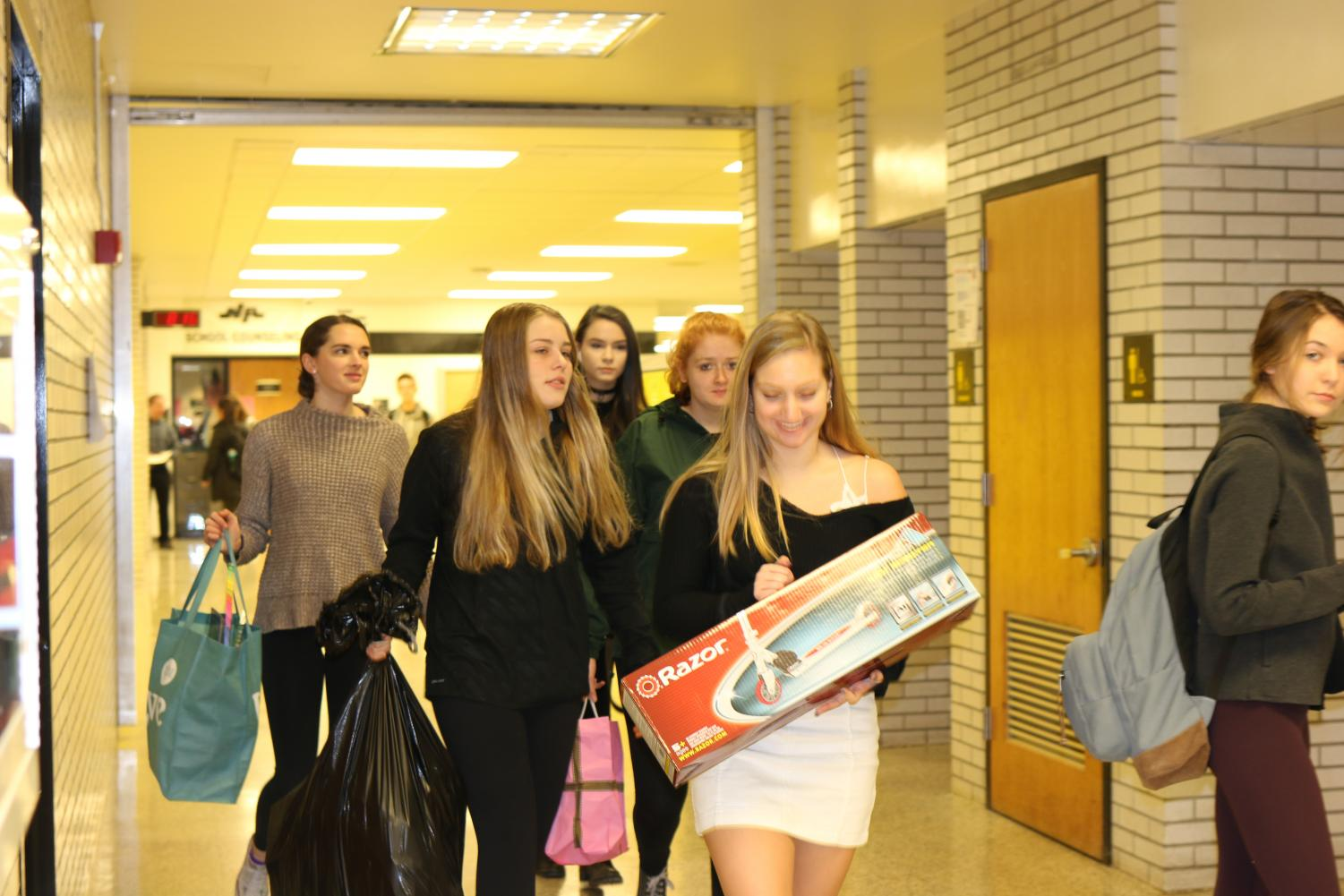 Homeroom+students+flocked+to+the+NASH+lobby+to+deliver+their+presents.