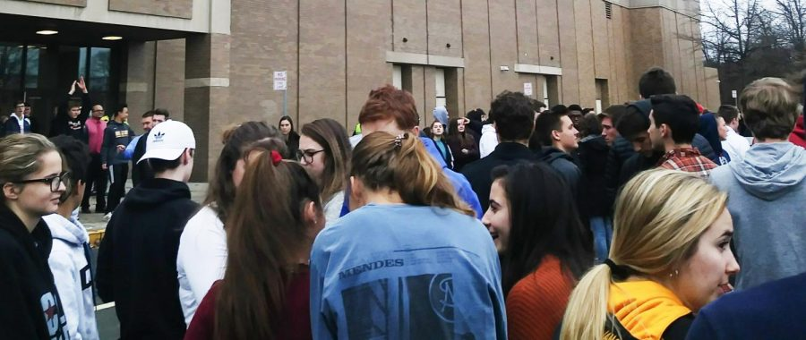 Students+gather+outside+the+NASH+campus+during+a+routine+December+fire+drill.