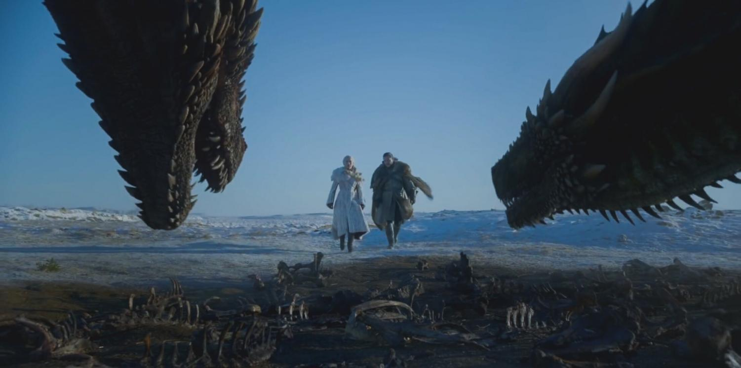 Jon and Daenerys standing side by side and they approach Drogon and Rhaegal.