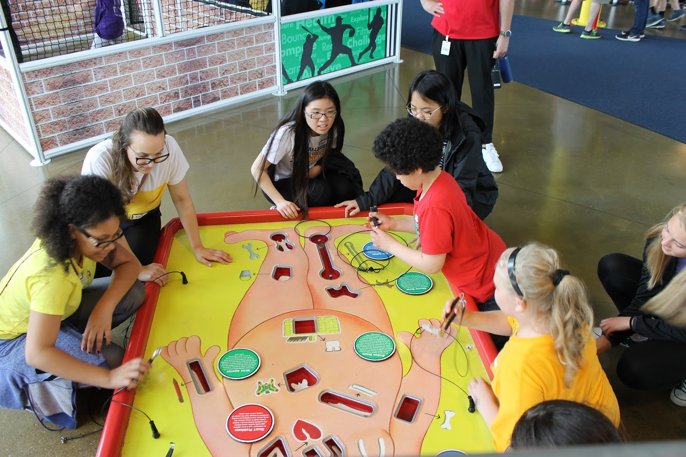 Emma Gunn and Sarah Wang meet with Grandview Elementary students at the Carnegie Science Center,