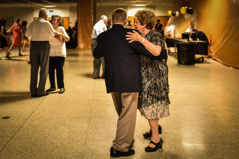 Marilin O'Brien dances the night away with her husband.