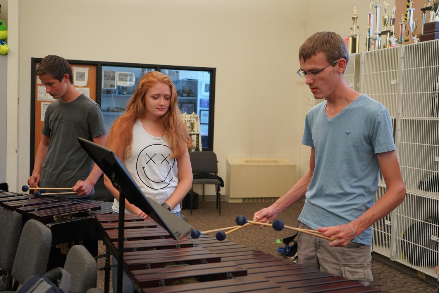 2%3A30+Alex+Hoare+and+Noah+DiBiasi+play+the+marimba+with+two+mallets+in+each+hand%2C+as+Lily+Stromberg+watches+in+amazement.+