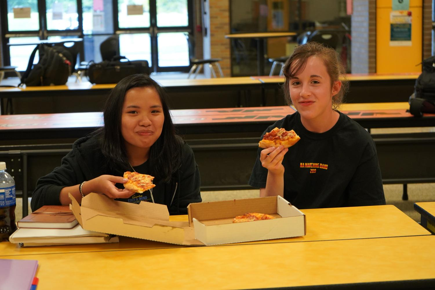 5%3A15+Holly+Dougherty+and+Hope+Wright+quickly+eat+their+pizza+as+call-time+approaches.