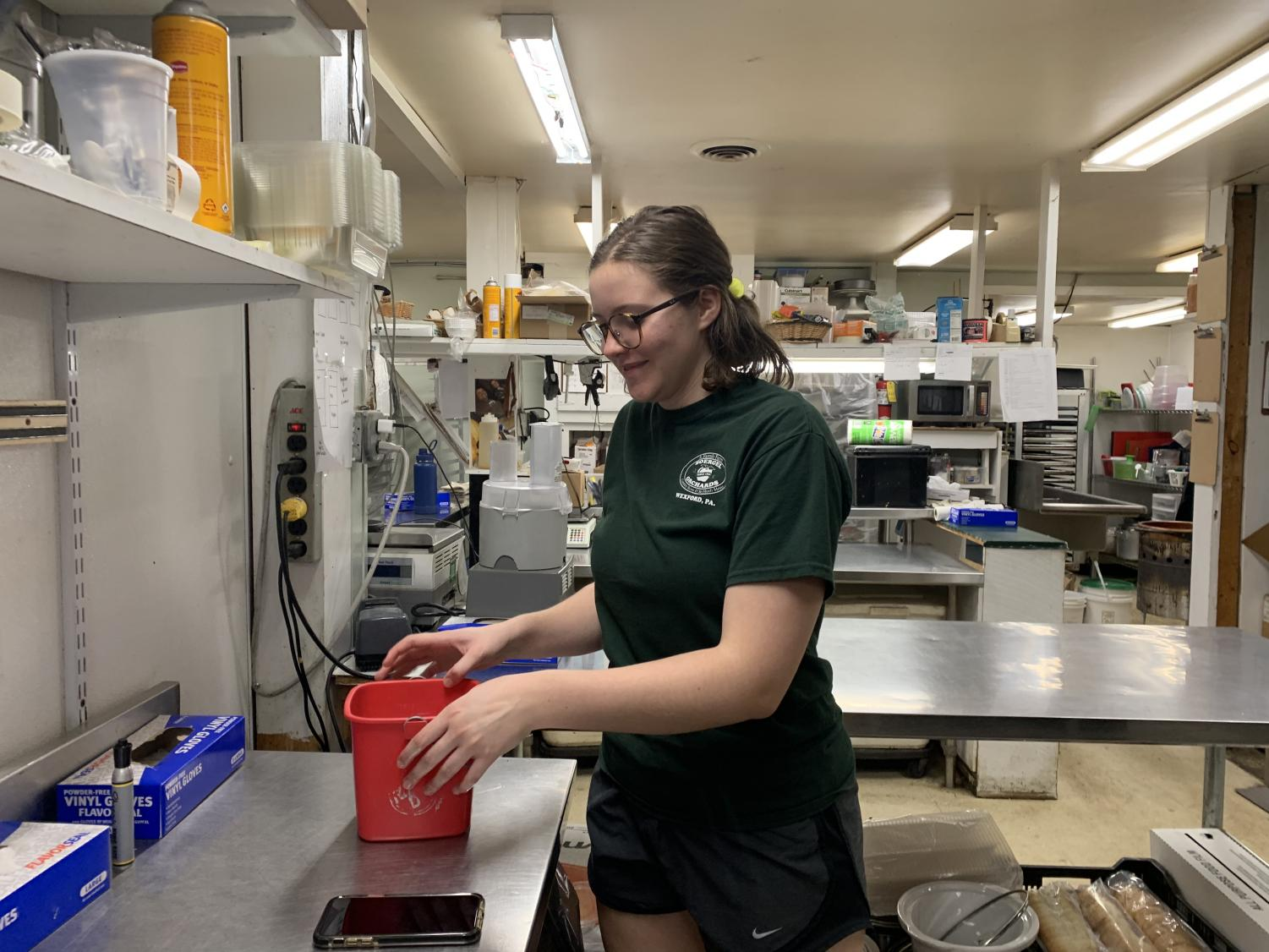 Scout Miller cleans the deli counter at Soergel's.  Like many students at NASH, Miller's part-time job is not always easy to manage alongside school work.