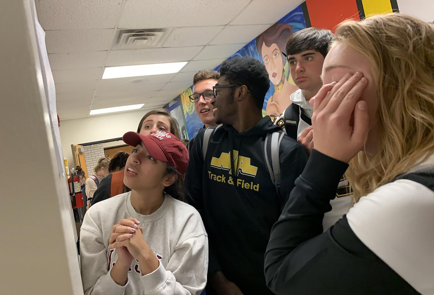 (L-R) Ava DiMartino, Emma Sula, Dylan Noker, Henry Mokube, Josh Truesdell, and Sarah Johns anxiously scan the spring musical callback list posted on September 27th.