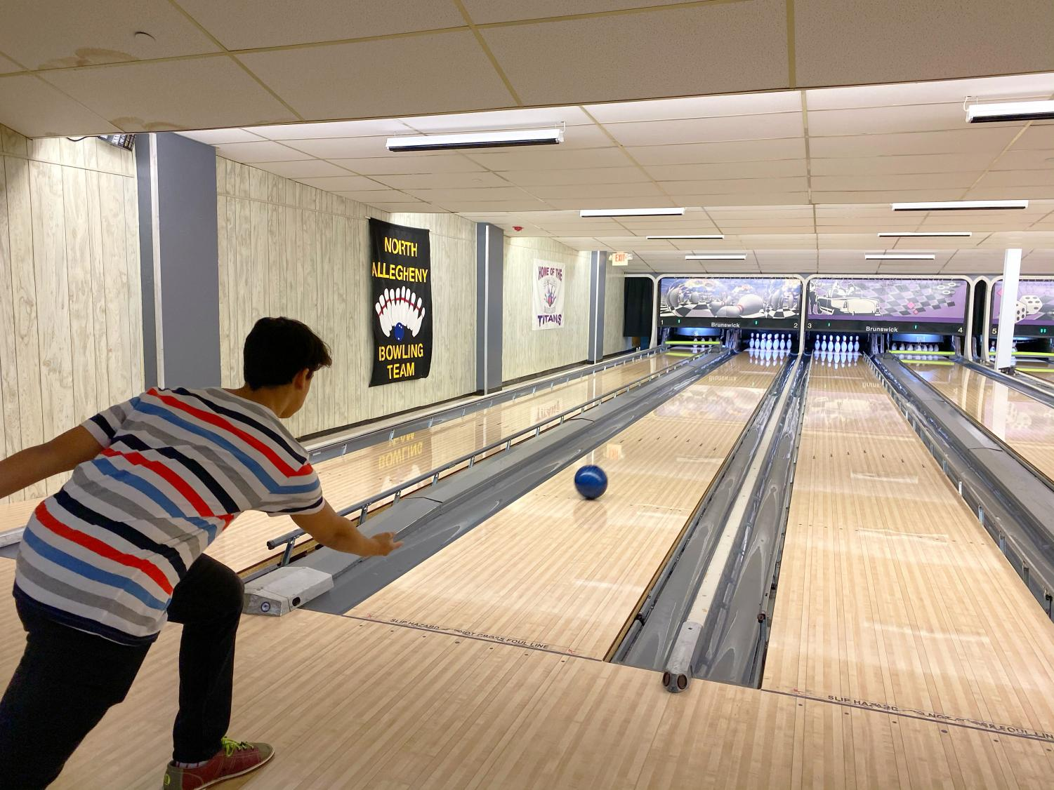NASH junior Yaseen Sabil aims for a strike last Friday at Perry Park Lanes.  Sabil and others in the Muslim Student Association hosted a meeting at the bowling alley to build community around friendly competition, food, and fun.