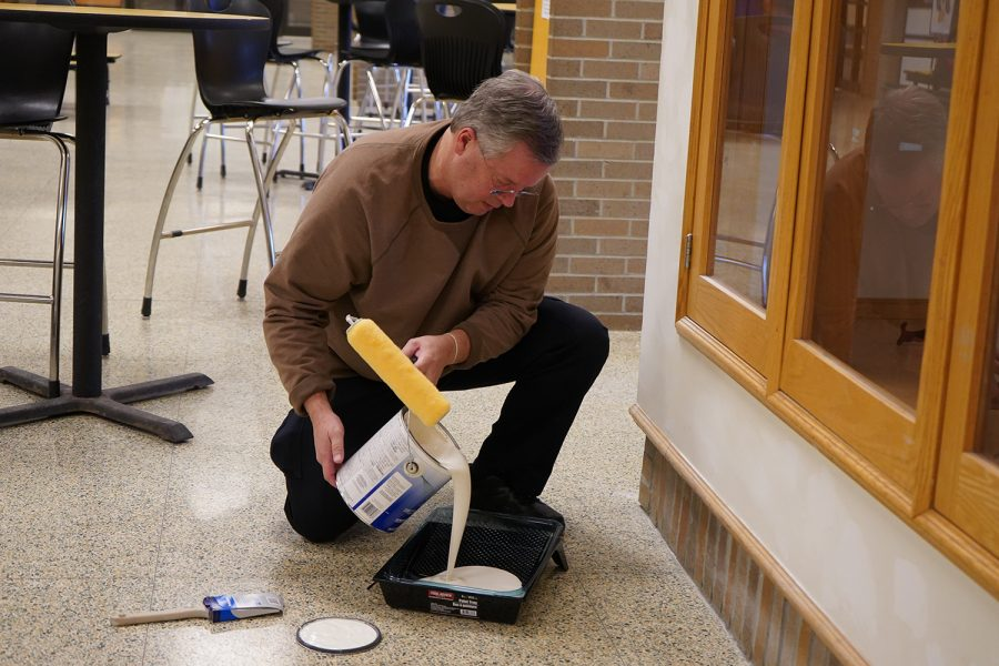 Officer Ray has been devoting his time after school hours to renovating the trophy case at the front of the cafeteria.