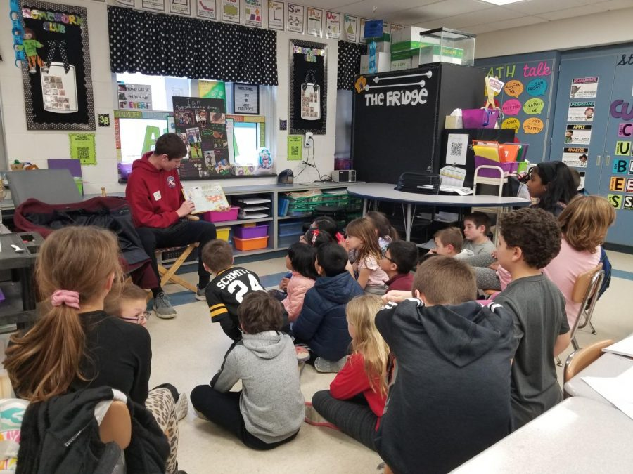 NASH senior Eric Mole reads a Dr. Suess book to students at his elementary alma mater, Bradford Woods Elementary, this past Monday for Read Across America Day.