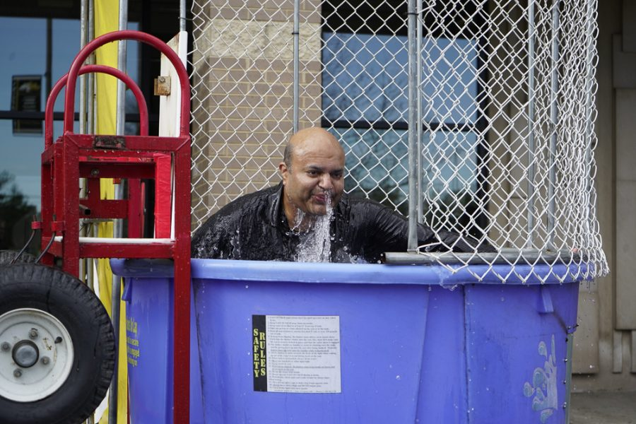 Best Buddies rented a dunk tank during the lunch periods today to raise money for the organization, as well as allow students to exact a little retribution on their teachers, such as Mr. Kodenkandeth, pictured above.