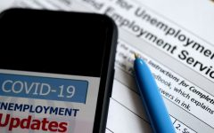 In this photo illustration, a COVID-19 Unemployment Assistance Updates logo is displayed on a smartphone on top of an application for unemployment benefits on May 8, 2020, in Arlington, Virginia. - With shops and factories closed nationwide due to the coronavirus pandemic, nearly all of the jobs created in the US economy in the last decade were wiped out in a single month. An unprecedented 20.5 million jobs were destroyed in April in the world's largest economy, driving the unemployment rate to 14.7 percent compared to 4.4 percent in March, the Labor Department said in its monthly report, the first to capture the impact of a full month of the lockdowns. (Photo by Olivier DOULIERY / AFP) (Photo by OLIVIER DOULIERY/AFP via Getty Images)