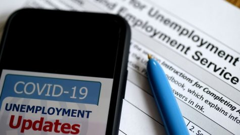 In this photo illustration, a COVID-19 Unemployment Assistance Updates logo is displayed on a smartphone on top of an application for unemployment benefits on May 8, 2020, in Arlington, Virginia. - With shops and factories closed nationwide due to the coronavirus pandemic, nearly all of the jobs created in the US economy in the last decade were wiped out in a single month. An unprecedented 20.5 million jobs were destroyed in April in the world