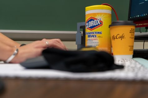 This year, disinfectant and hand sanitizer rank alongside coffee and computers as back-to-school essentials.