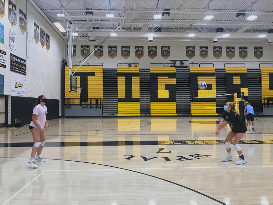Jadyn+Perkins+and+Mia+Tuman+pass+the+ball+from+a+safe+distance+at+a+recent+volleyball+practice.