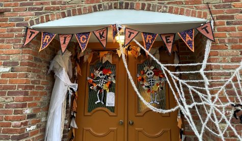 While the decorations around the door may look the same, traditional trick-or-treating should be anything but.