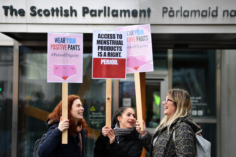 Activists rally in front of the Scottish Parliament in Edinburgh earlier this year in support of the Period Products Bill.