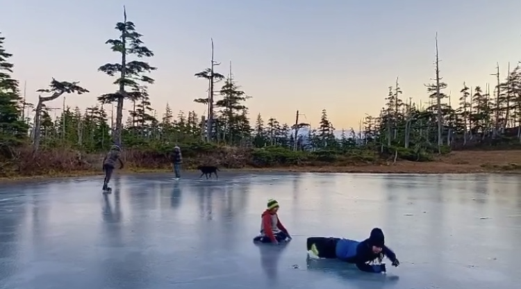 Chenega Village kids playing on the ice.  The Alaskan island has had no positive cases of COVID-19 since the start of the pandemic.