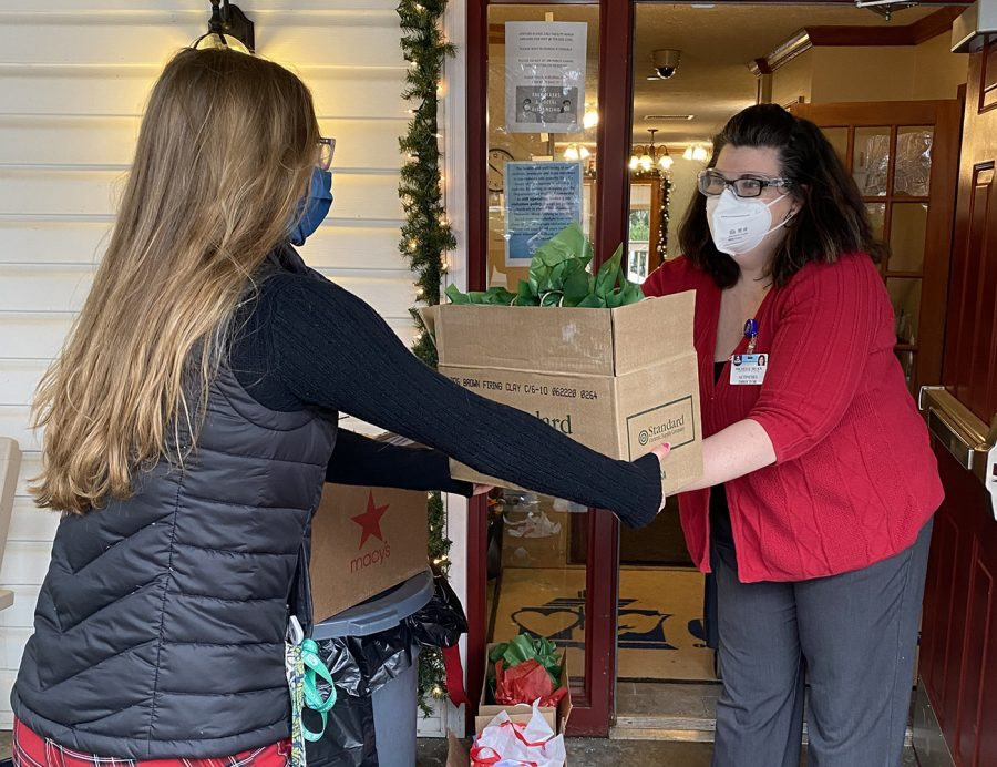NASH senior Liv Schenk delivers student-made pottery and household items to a local nursing home, as part of her Pottery for Patients initiative.