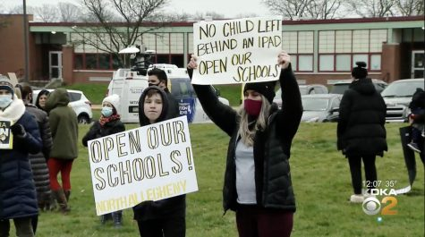 On Monday, over a dozen parents and students came together to protest the extension of remote learning.