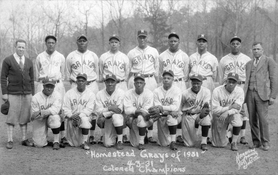 MLB's recent decision to include Negro League stats in its record books may prove that Josh Gibson (fourth from the right in the back row) was the greatest hitter of all time.