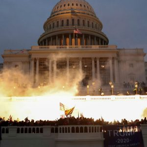 The insurrection at the Capitol on January 6th continued among flames.