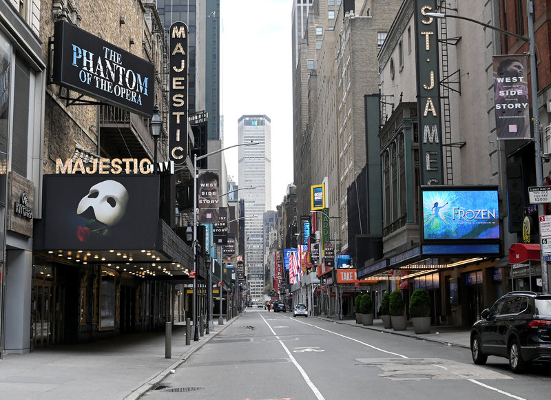 Nothing but dimmed lights and dark marquees are left on the once-bustling streets of Broadway.