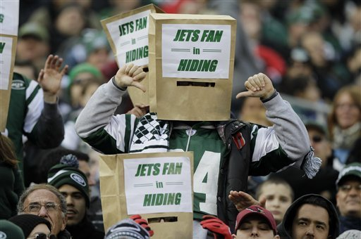 Spectators use paper bags over their heads during the first half of an NFL football game between the New York Jets and the Arizona Cardinals, Sunday, Dec. 2, 2012, in East Rutherford, N.J. (AP Photo/Kathy Willens)