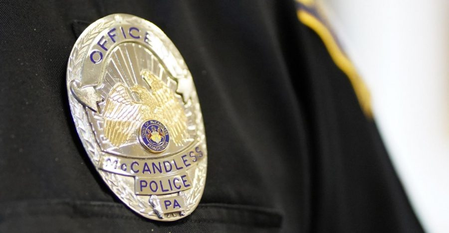The badge that sits on NASH School Resource Officer Ray's uniform is a symbol of his dedication to public safety.