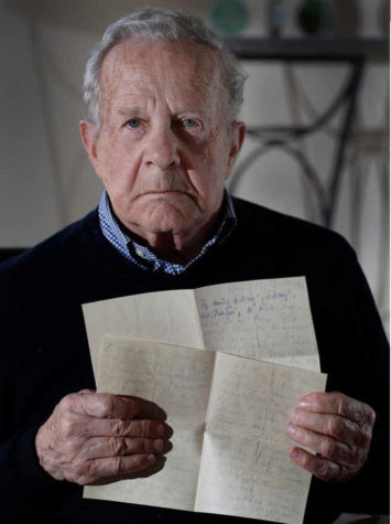 Survivor, Frank Grunwald, holds up the goodbye letters that his mother wrote to his father before she and her eldest son were sent to the Nazi gas chambers.