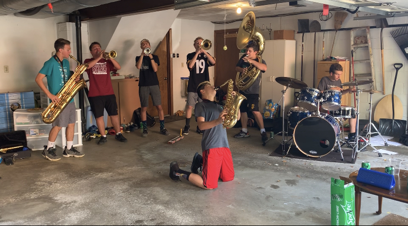 The 7 Degrees Brass Band rehearses in band member Logan Henderson's garage.
