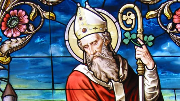 A stained-glass window with portrait of St. Patrick.