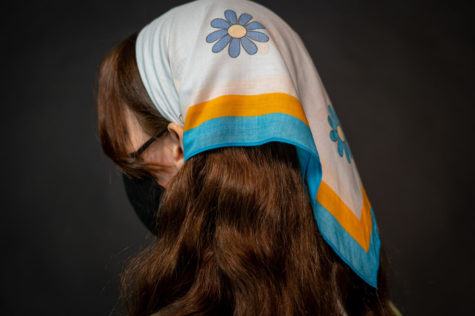 Michaela Golik styles her floral headscarf, a rising trend this 2021 spring season.