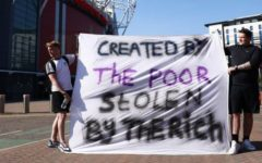 Supporters protest the proposed European Super League outside of Old Trafford