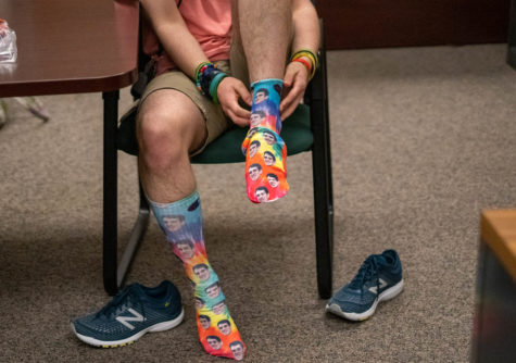 Patrick Birmingham puts on his brand new socks for the first time early Friday morning.
