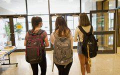 NASH juniors Halle Marsalis, Sonia Lofgren, and Chelsea Boyer walk the doors of NASH two days before they become seniors.