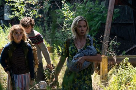 The family makes their way through the forest cautiously and as quietly as possible.