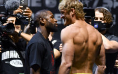 Floyd Mayweather, left, and Logan Paul pose for photographers during a weigh-in Saturday, June 5, 2021, in Hollywood, Fla. Paul is scheduled to fight Mayweather in an exhibition boxing match at Hard Rock Stadium in Miami Gardens, Fla., Sunday. (AP Photo/Jim Rassol) ORG XMIT: FLJS103