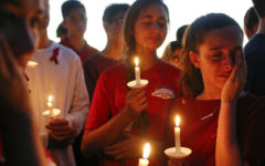 Students gather to grieve during a vigil at Pine Trails Park for the victims of the Wednesday shooting at Marjory Stoneman Douglas High School, in Parkland, Fla., Thursday, Feb. 15, 2018. Nikolas Cruz, a former student, was charged with 17 counts of premeditated murder on Thursday. (AP Photo/Brynn Anderson)