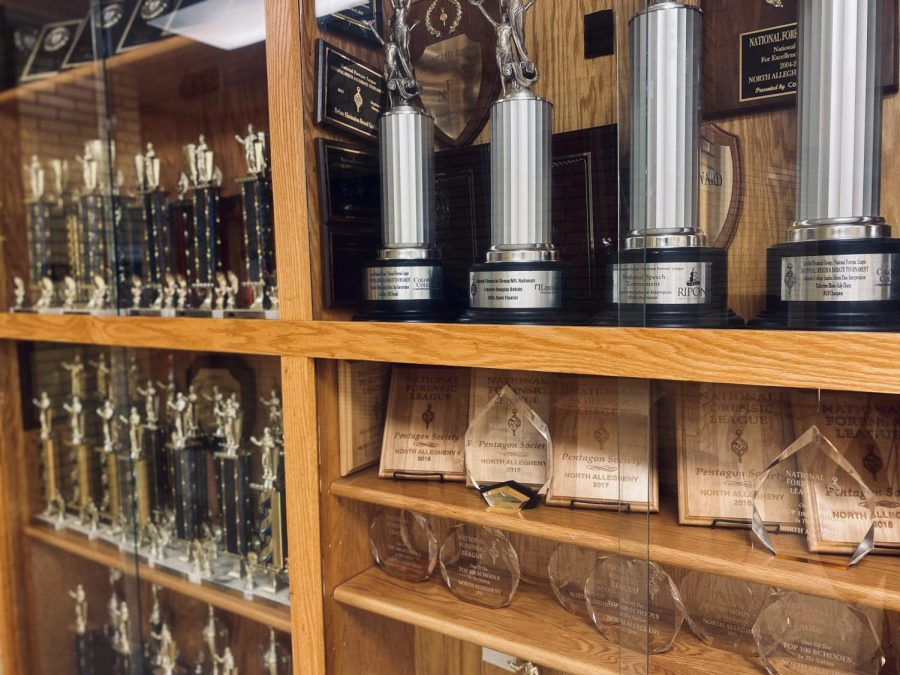 The hallway outside Mrs. Volpe's room is bookended by floor to ceiling trophy cases filled with student accolades.