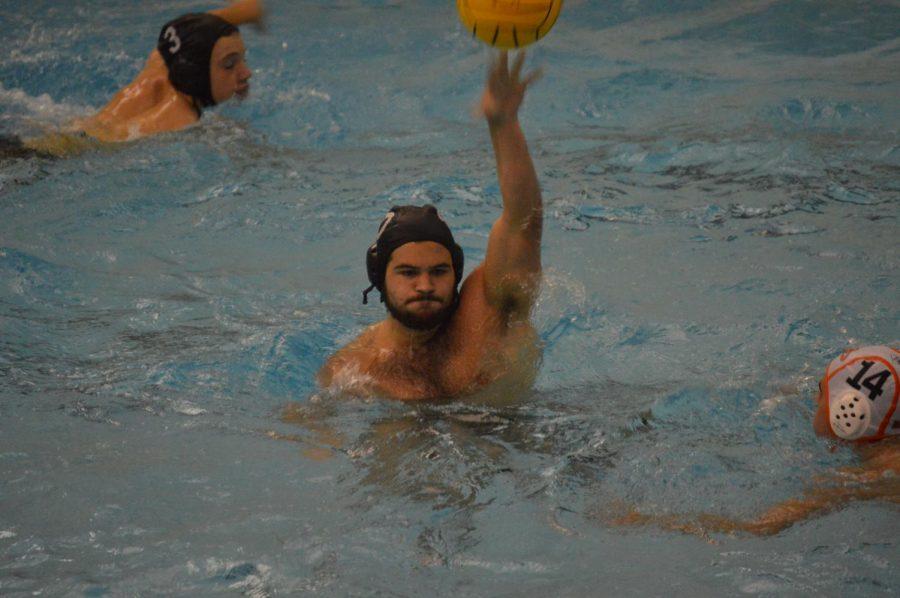 NA senior Marko Kosanovich helps lead the NA boys' team to victory during Saturday's tournament.