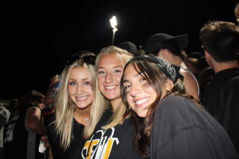 These three ladies are still smiling for the camera despite the Tigers going into halftime behind 14-7.