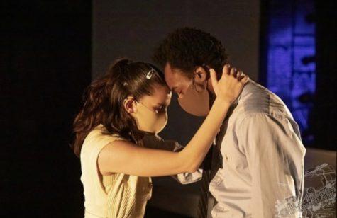 Selena Williams (Cora) and LaTrea Derome (Milton) embrace in a scene during the musical.
