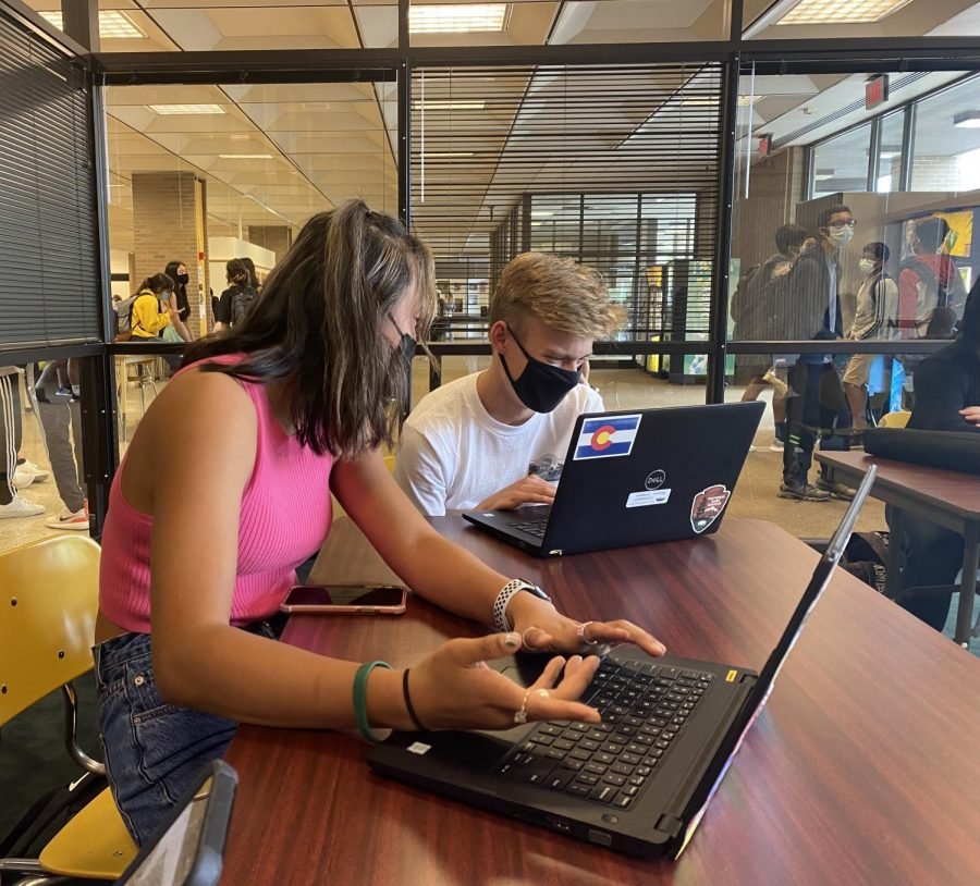 Seniors Chelsea Boyer (left) and Ben Lindgren (right) at a Student Council meeting to plan homecoming events.