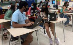 Former NACA students Abhi Yarlagadda, Anjali Bandi, and Sonya Dhussa hard at work in class.