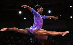 With a total of 32 combined Olympic and World medals, Simone Biles is tied for the most decorated gymnast of all time.