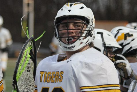 Senior backup lacrosse goalie Joe Graper has not been on the field for a single minute of varsity play, but his vocal support from the sidelines makes him one of the most valued members of the team.