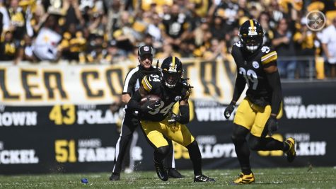 Steelers safeties Terrell Edmunds and Minkah Fitzpatrick look to return the ball after an interception.